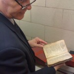 Mark holding the LC's 1640 Bay Psalm Book