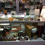 "Front display case with miniatures, artist's books, and the illustrious ""Thunderbook"